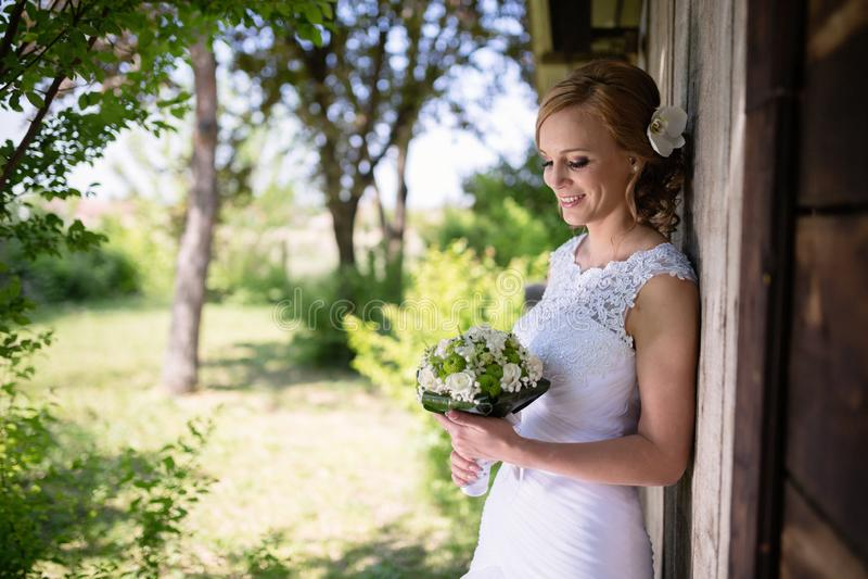 Beautiful bride posing outdoors stock photos