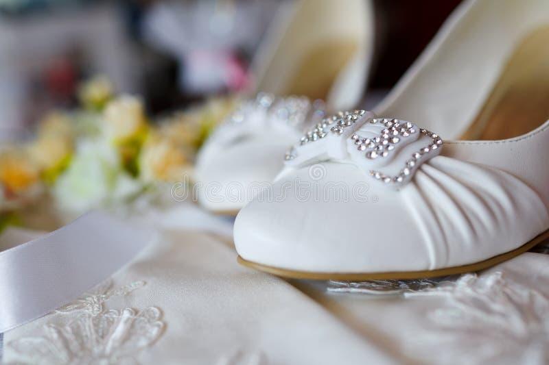 Beautiful bride's shoes. Closeup photo of beautiful bride's shoes royalty free stock photo