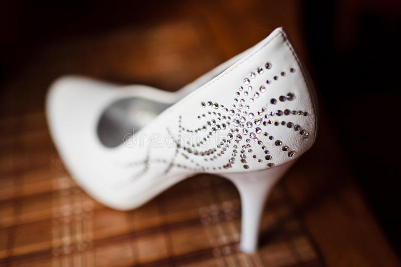 Beautiful bride's shoes. Closeup photo of beautiful bride's shoes royalty free stock image