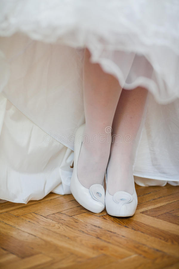 Beautiful bride's shoes. Closeup photo of beautiful bride's shoes stock image