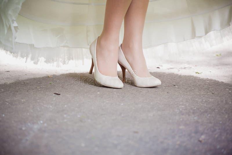 Beautiful bride's shoes. Closeup photo of beautiful bride's shoes royalty free stock photography