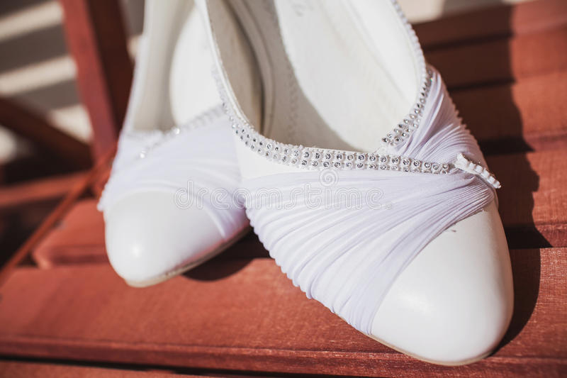 Beautiful bride's shoes. Closeup photo of beautiful bride's shoes stock images