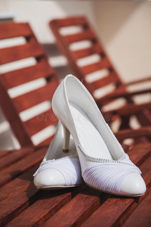 Beautiful bride's shoes. Closeup photo of beautiful bride's shoes royalty free stock images