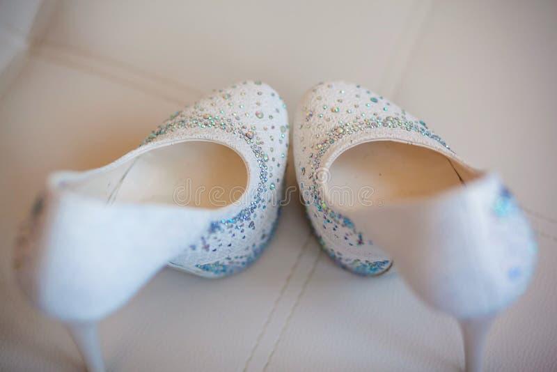 Beautiful bride's shoes. Closeup photo of beautiful bride's shoes stock image