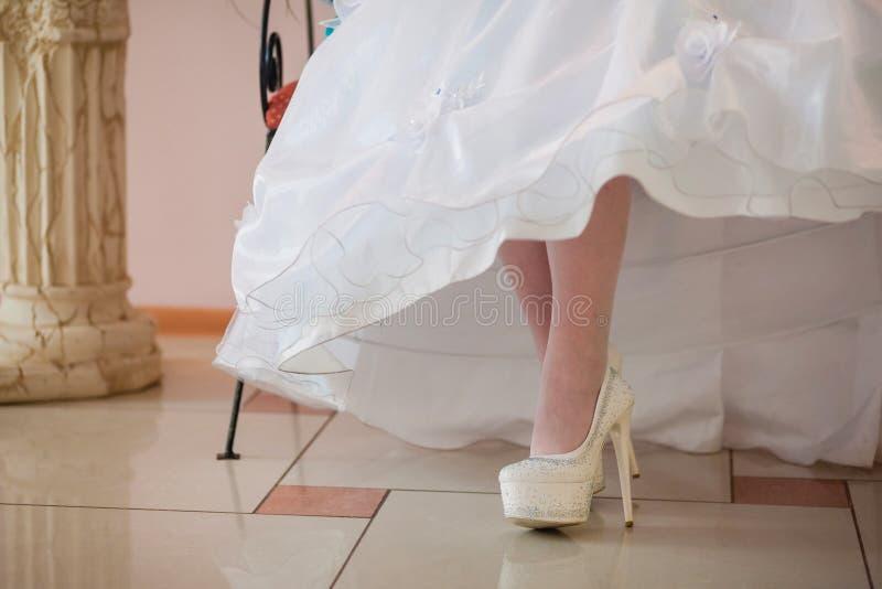 Beautiful bride's shoes. Closeup photo of beautiful bride's shoes stock photography