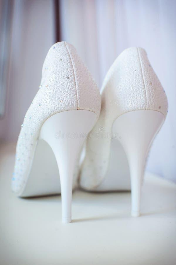Beautiful bride's shoes. Closeup photo of beautiful bride's shoes stock photos