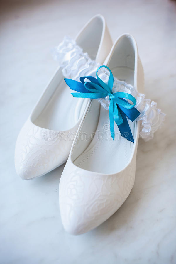 Beautiful bride's shoes. Closeup photo of beautiful bride's shoes stock photo