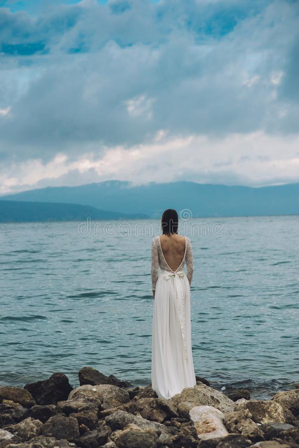 Beautiful Bride standing by the Sea. Destination wedding concept. Wedding on exotic island. royalty free stock photos