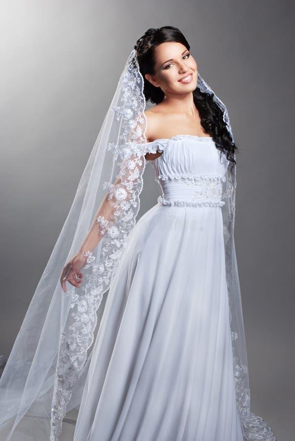 Beautiful bride is standing in wedding dress stock photos