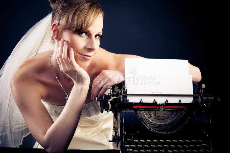 Beautiful Bride With Typewriter royalty free stock images