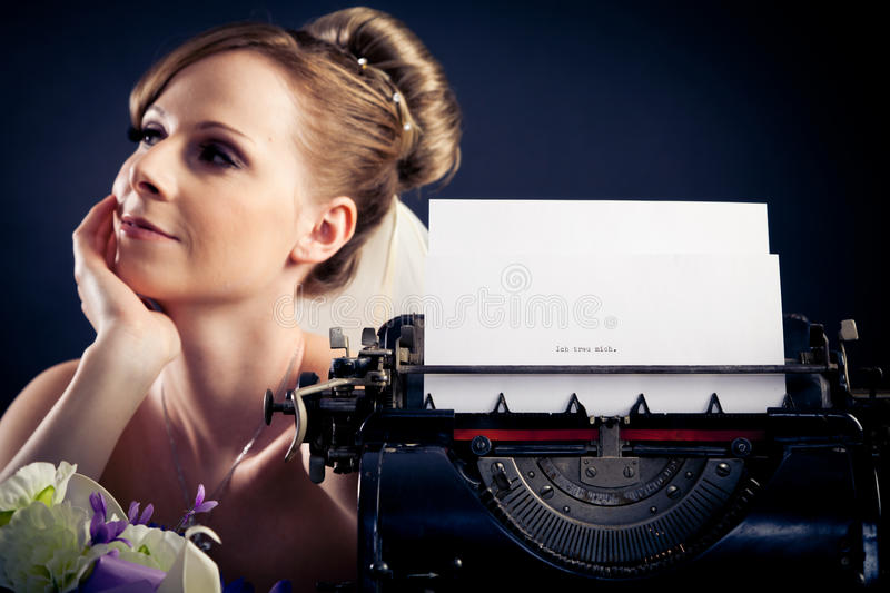 Beautiful Bride With Typewriter royalty free stock photos