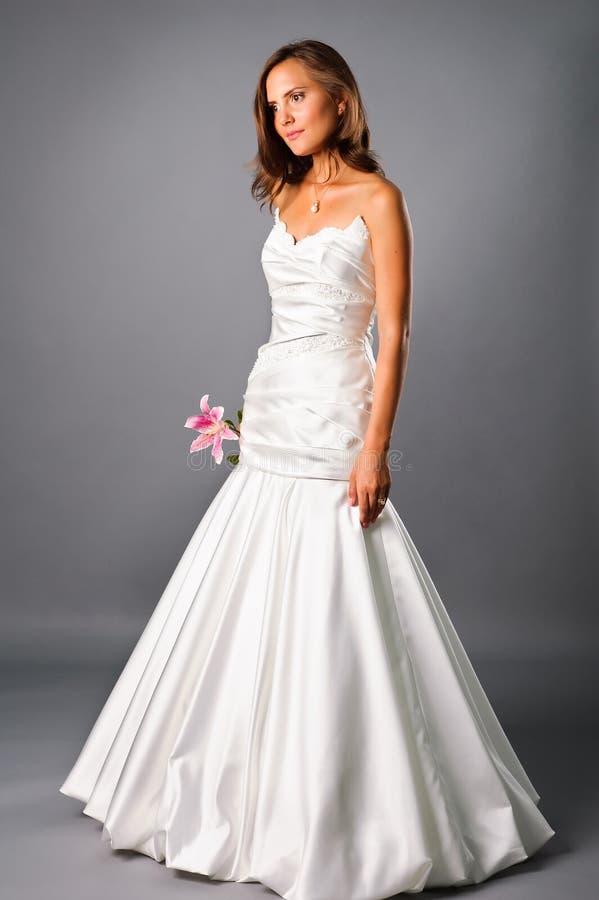 Beautiful bride wearing wedding dress in studio