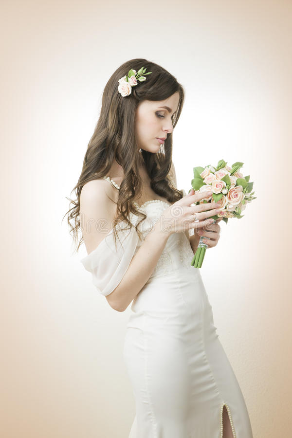Beautiful bride with wedding bouquet royalty free stock image