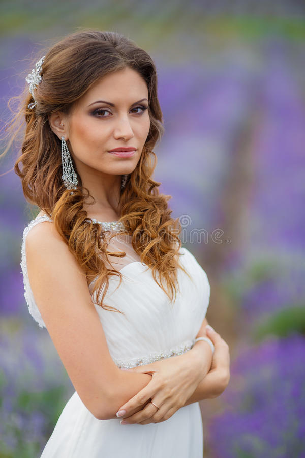 Beautiful bride in wedding dress in lavender field royalty free stock photography