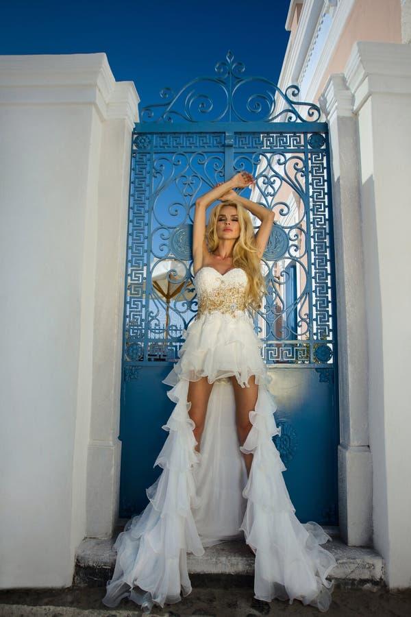 The beautiful bride in a wedding dress on Santorini in Greece. stock photos
