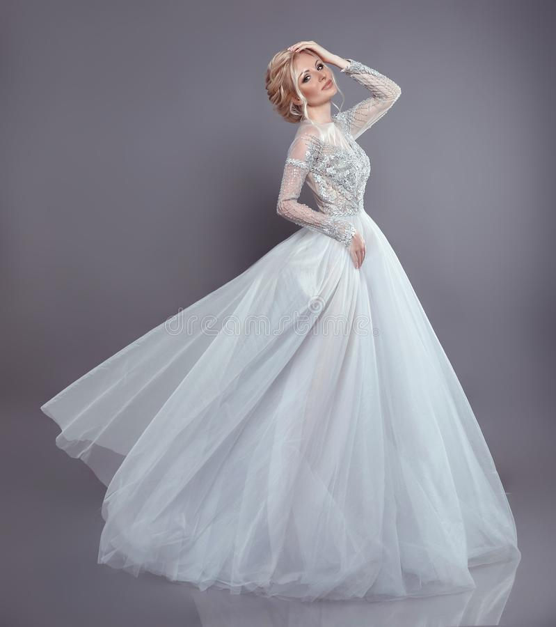 Beautiful bride in wedding flowing chiffon dress, Woman in long. Flying blowing gown. Stunning fashion model. Attractive blonde in fabric waving Cloth Flowing royalty free stock photos