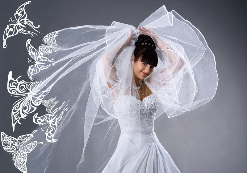 Download Beautiful Bride In A White Dress With Butterflies Royalty Free Stock Image - Image: 10961466