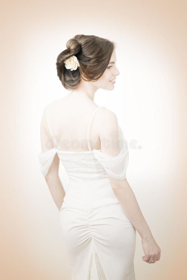 Beautiful bride in a white dress stock photography