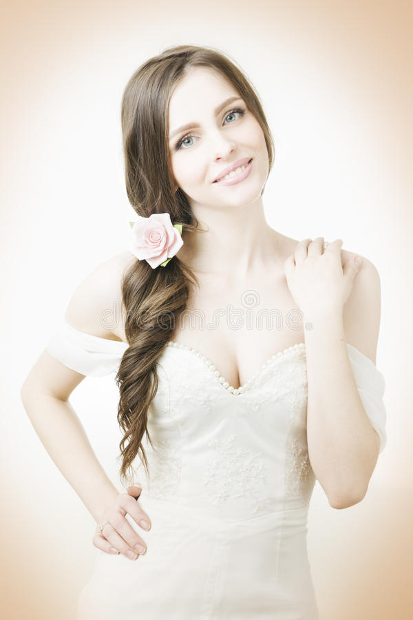 Beautiful bride in a white dress stock photos