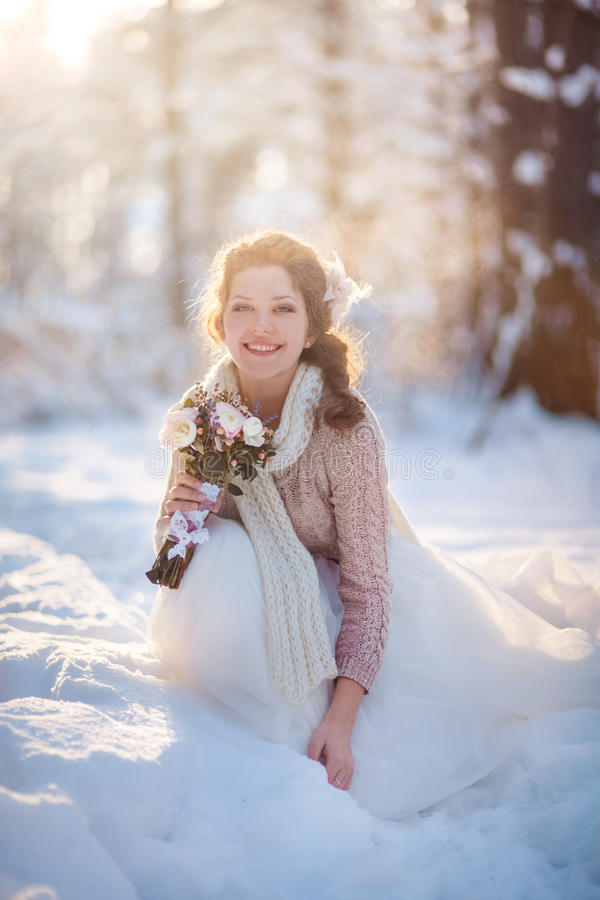 Beautiful bride in winter forest royalty free stock image