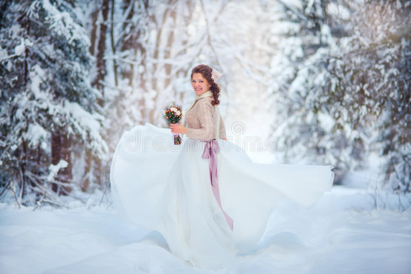 Beautiful bride in winter forest royalty free stock photos