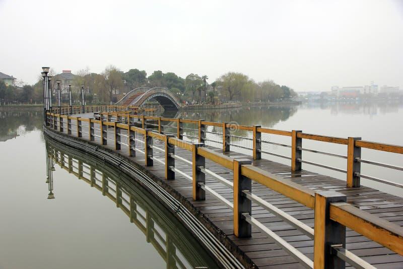 Beautiful bridge in chinses city park royalty free stock photo