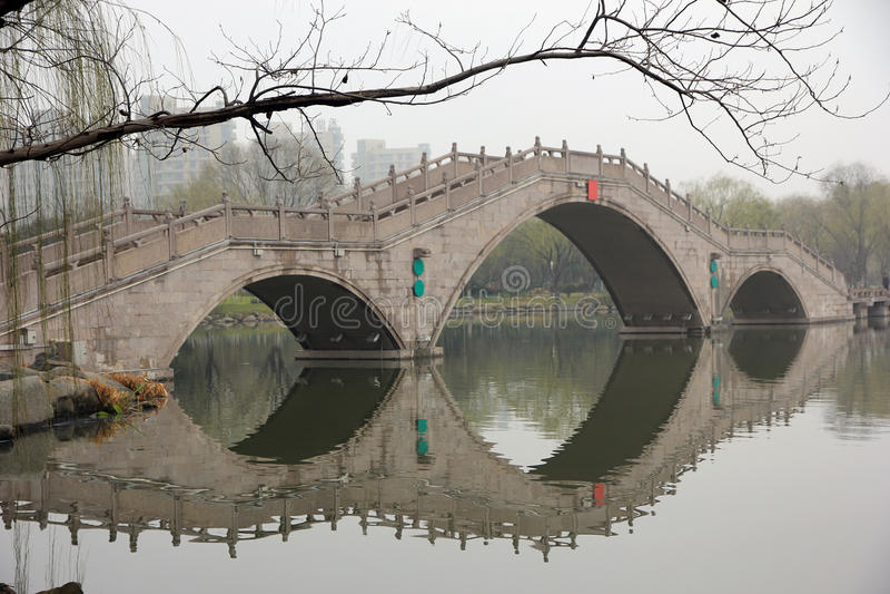 Beautiful bridge in chinses city park stock photography