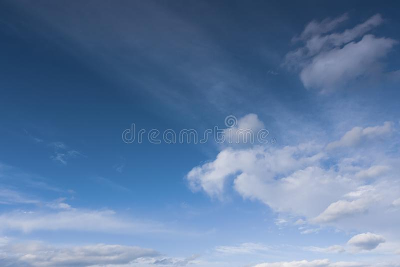 Beautiful bright blue sky with white fluffy clouds on a clear Sunny day stock images