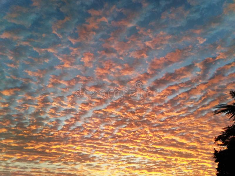 Beautiful bright cloud patterns on sky. Stunning cloud patterns in high sk view of sky the sun makes clouds colorful ,clouds look like waves stock photo