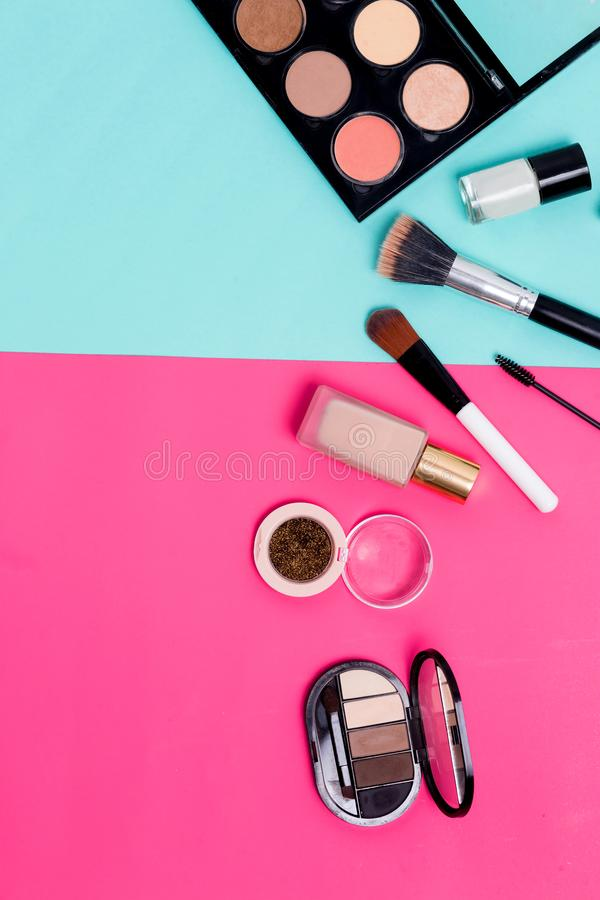 Beautiful bright cosmetics, makeup products on a colorful background with copy space for text. royalty free stock images
