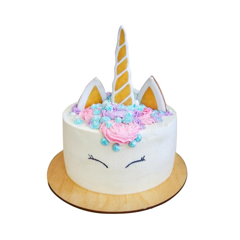 Beautiful bright delicious birthday cake for girls decorated in form of fantasy unicorn. Isolated on white stock photo