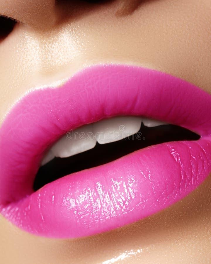 Beautiful bright Fashion Make-up on full Lips. Trend pink lip Makeup. Vivid shiny Lipgloss royalty free stock photo