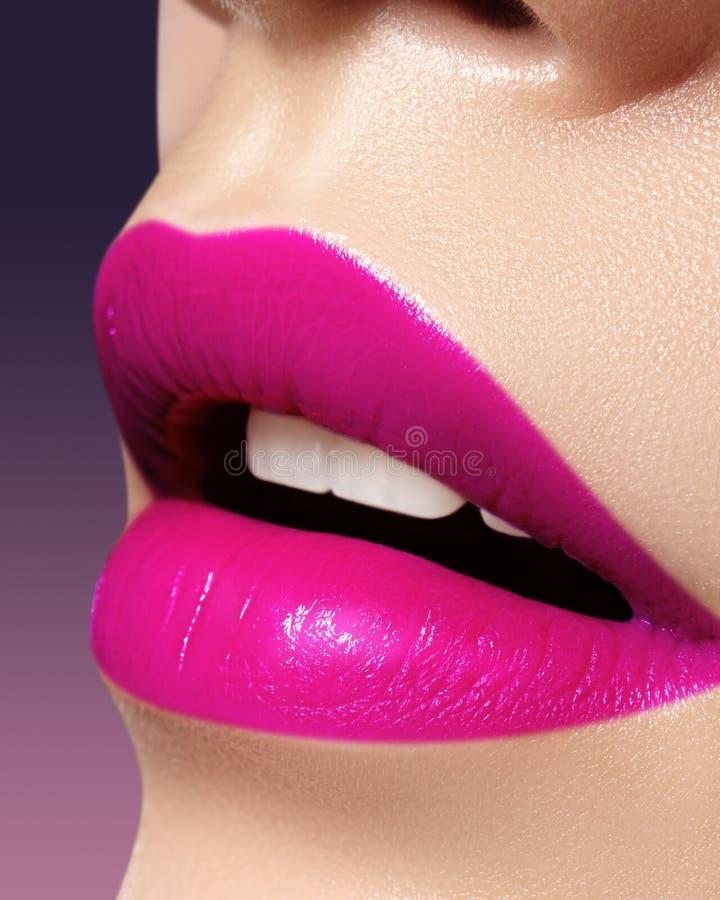 Beautiful bright Fashion Make-up on full Lips. Trend pink lip Makeup. Vivid shiny Lipgloss royalty free stock images