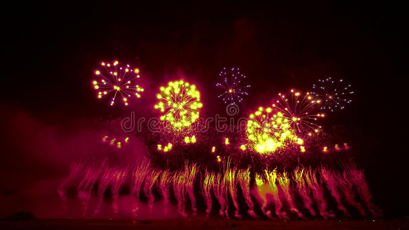 Beautiful and bright firework balls in the night sky stock illustration