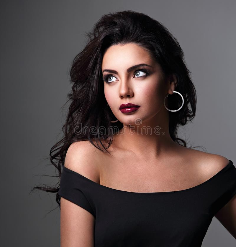 Free Beautiful Bright Makeup Woman With Long Black Curly Volume Black Hair Style, Burgundy Lipstick With Vamp Looking Up Stock Photos - 162201893