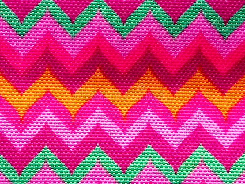 Beautiful bright ornament on fabric royalty free stock photography