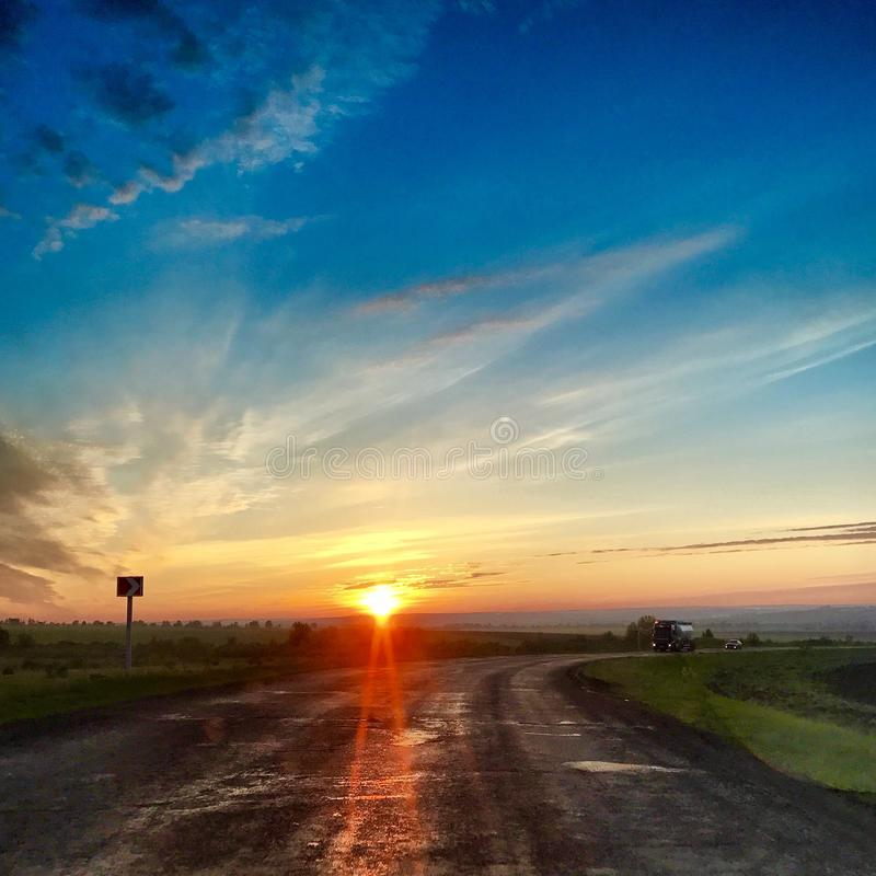 Beautiful and bright sunset on the way home royalty free stock photo