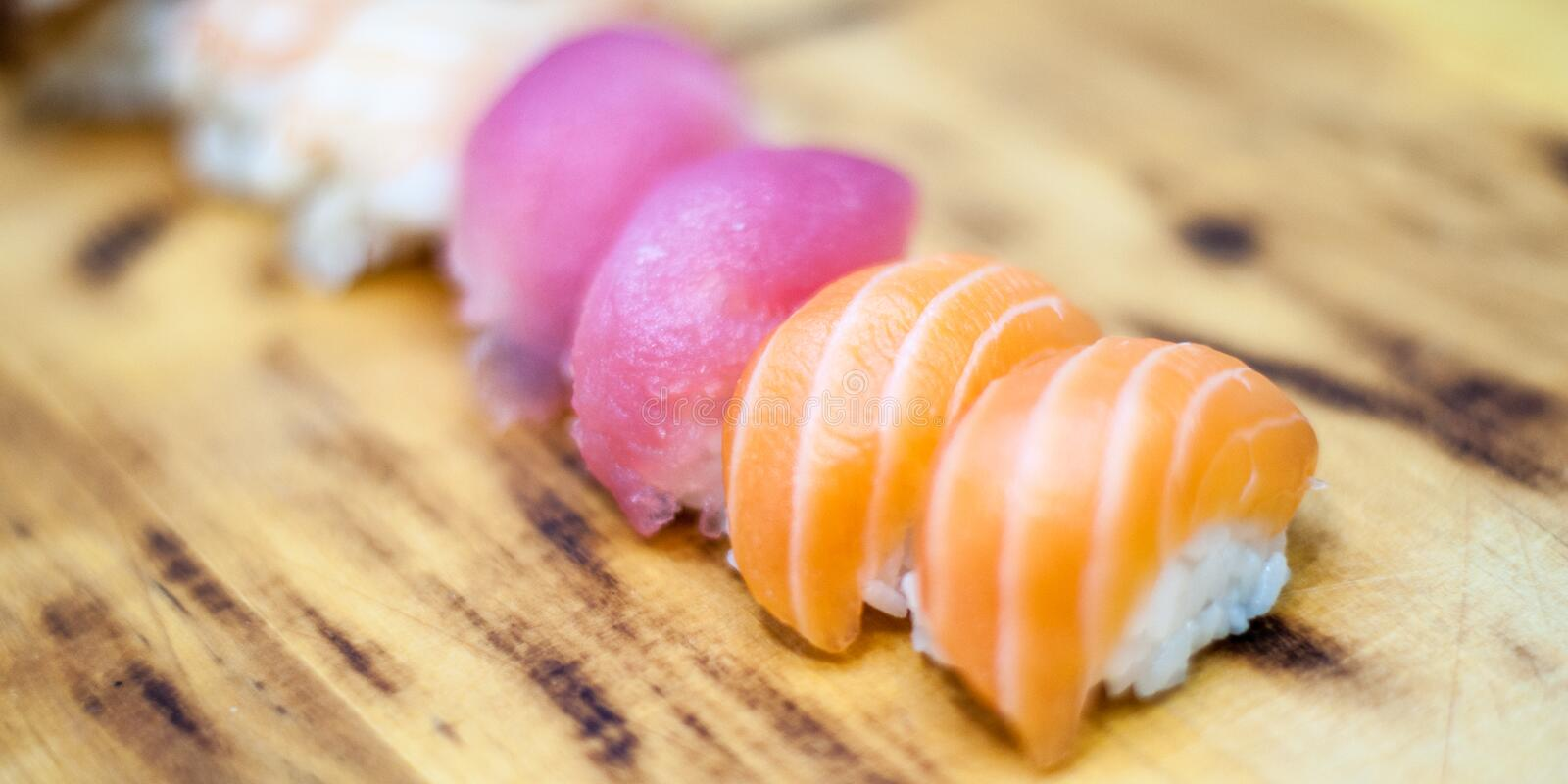 Beautiful, bright, sushi sets,as a background, against the backdrop, closeup. Japanese cuisine. Sushi with fresh ingredients over black background stock image