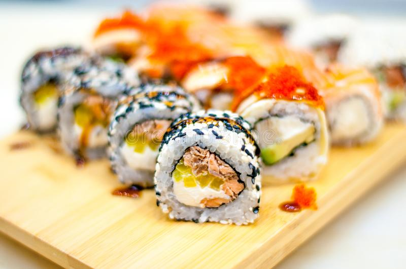 Beautiful, bright, sushi sets,as a background, against the backdrop, closeup. Japanese cuisine. Sushi with fresh ingredients over black background royalty free stock photo