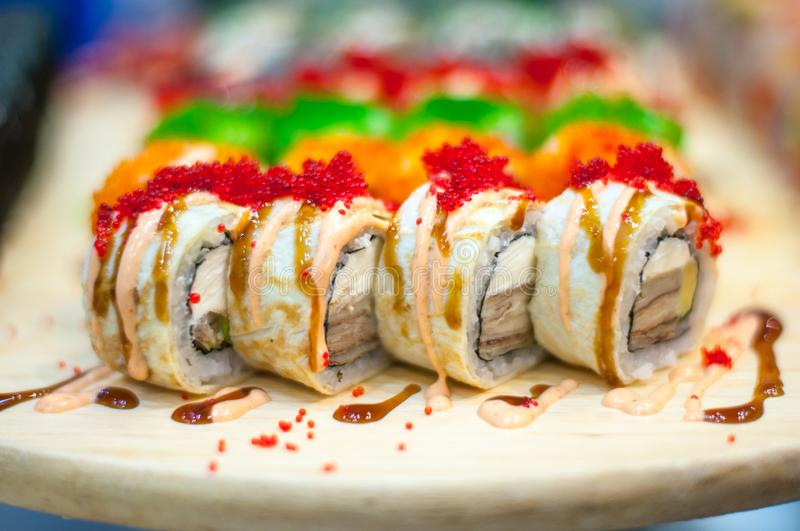 Beautiful, bright, sushi sets,as a background, against the backdrop, closeup. Japanese cuisine. Sushi with fresh ingredients over black background royalty free stock image