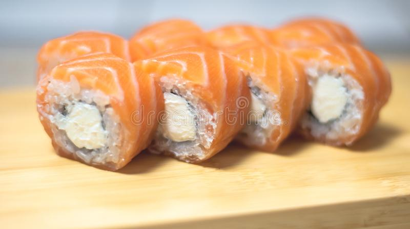 Beautiful, bright, sushi sets,as a background, against the backdrop, closeup. Japanese cuisine. Sushi with fresh ingredients over black background royalty free stock images