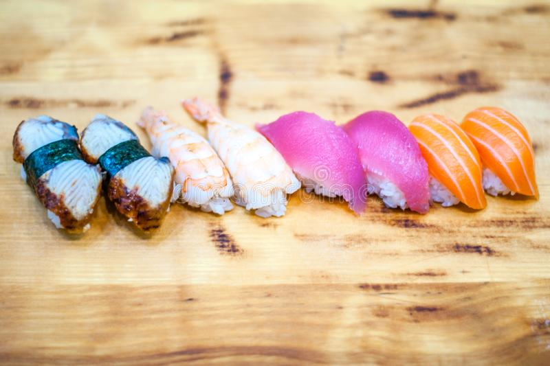 Beautiful, bright, sushi sets,as a background, against the backdrop, closeup. Japanese cuisine. Sushi with fresh ingredients over black background royalty free stock photography