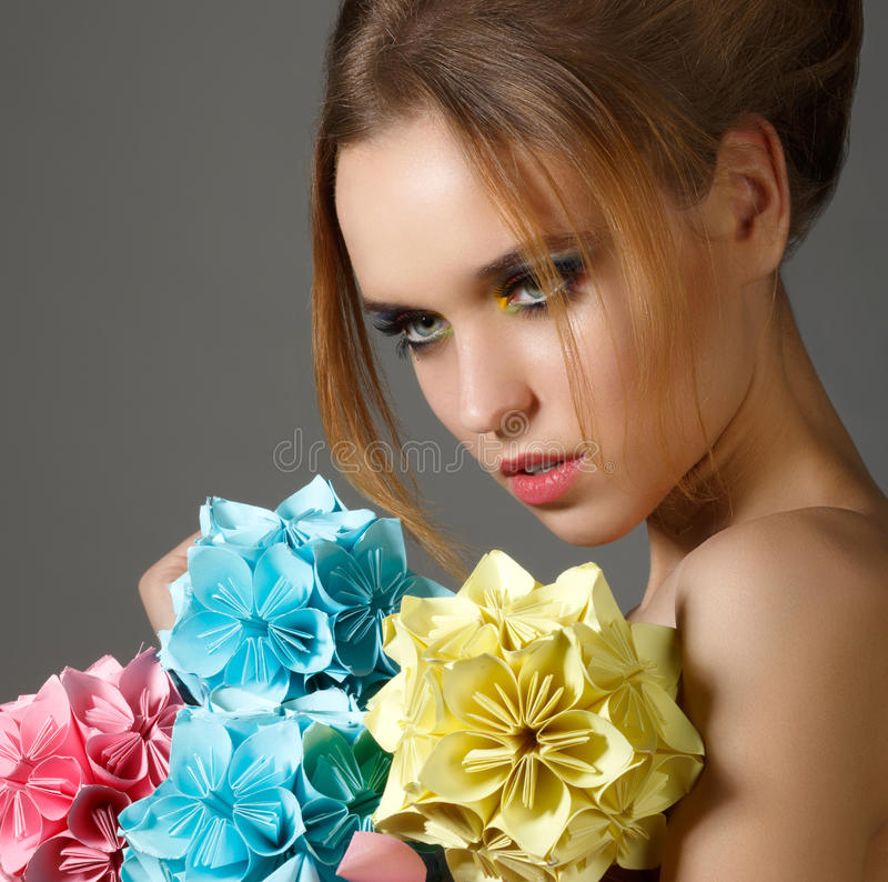 Beautiful Bright Woman holding Bouquet of Paper Origami Flowers royalty free stock photos