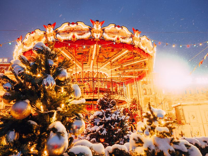 Beautiful brightly glowing carousel on the Red Square decorated and arranged for Christmas and New Year. Christmas fairy. Illuminated turnabout . Luminous stock photography