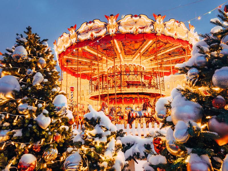 Beautiful brightly glowing carousel on the Red Square decorated and arranged for Christmas and New Year. Christmas fairy. Illuminated turnabout . Luminous royalty free stock photography