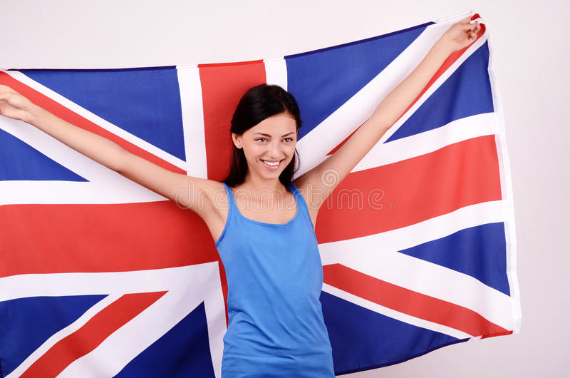 Download Beautiful British Girl Smiling Holding Up The UK Flag. Stock Photo - Image of beautiful, happy: 38578994
