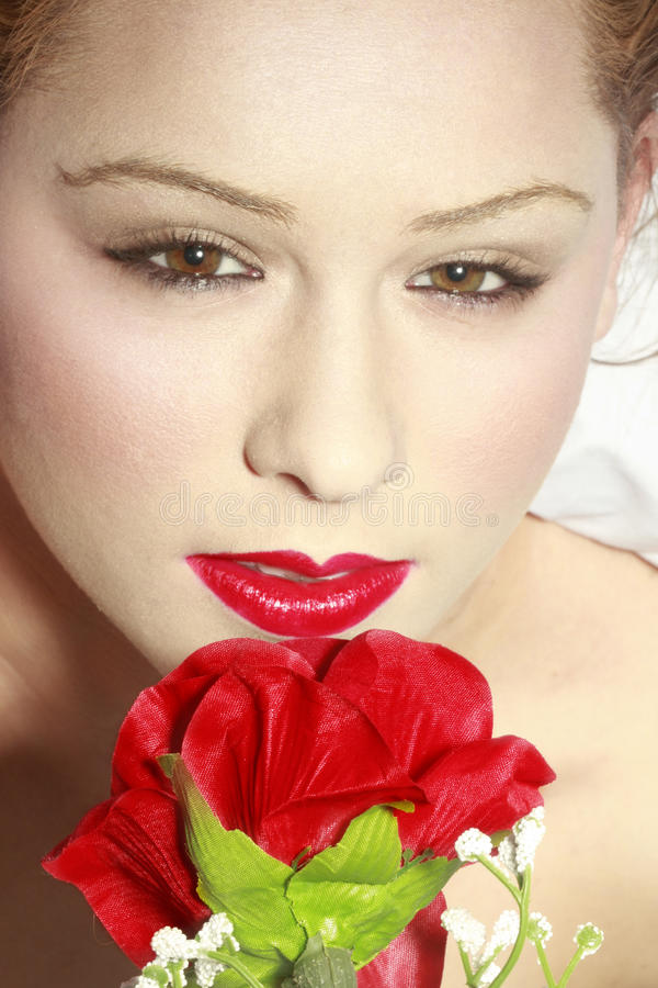 Beautiful Brown Eyed Girl With Rose Stock Photography