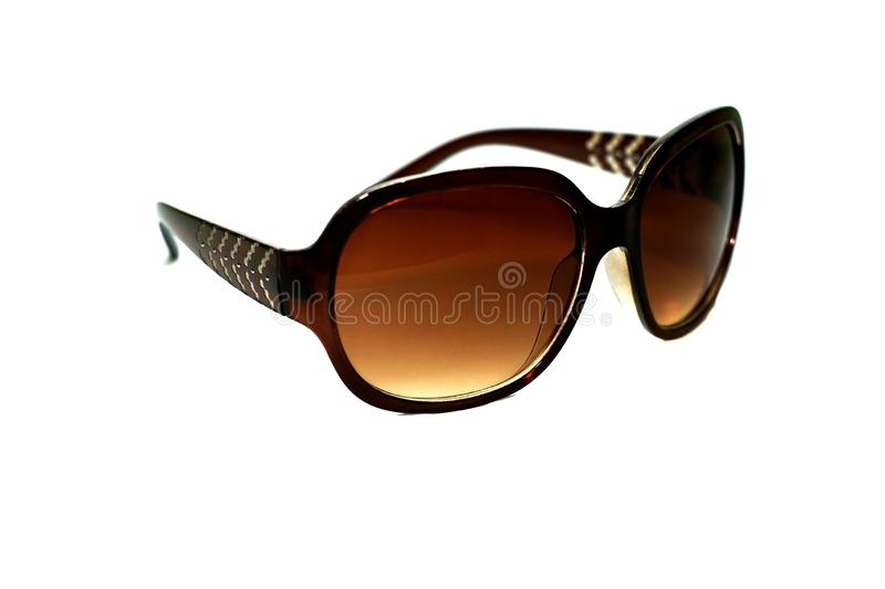 A brown Sun glasses on a white background royalty free stock photos