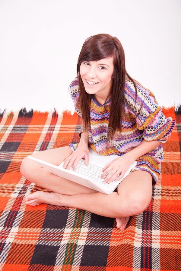 Beautiful brown teen girl with laptop royalty free stock photography