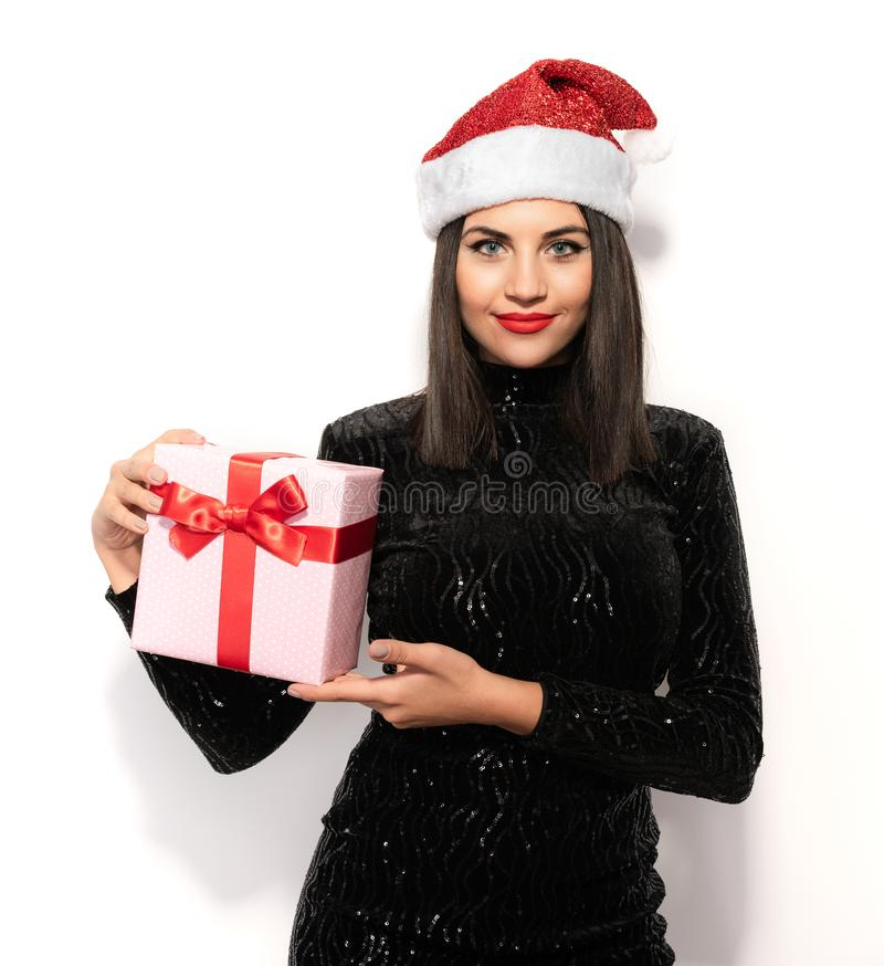 Beautiful Brunette in Black with Christmas Celebration Hat. Gift Concept stock photo